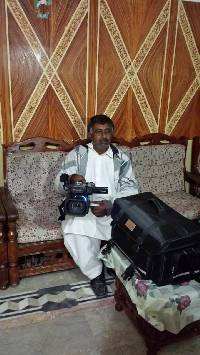 Munshi with video camera